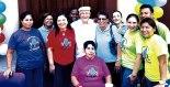 Equipo de voluntarios y maestra que trabajan con la Campaña Infantil.